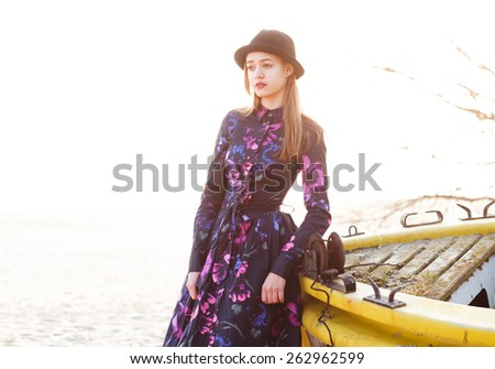 beautiful girl in the purple dress on the beach on a sunny day - stock photo