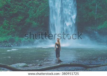 beautiful girl in the rain . beautiful girl in the waterfall . Vintage (author's treatment of light and color )