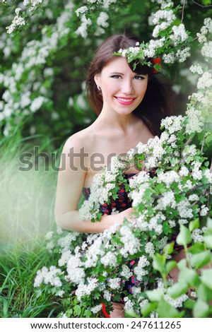 beautiful girl in the spring flowery park. - stock photo