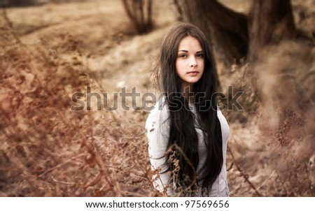 beautiful girl in the spring in the park - stock photo