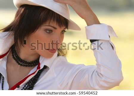 Beautiful girl in the white hat- soft background portrait - stock photo
