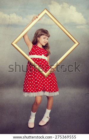 Beautiful girl in vintage spotted dress holding an empty frame.  Photo in retro style with old textured paper. - stock photo