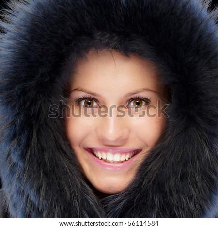 Beautiful girl in warm coat, isolated on black background. - stock photo