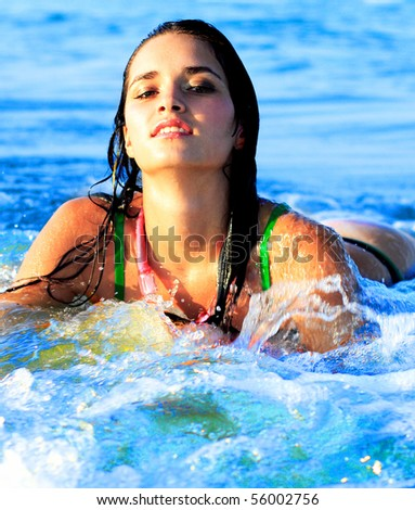 beautiful girl in water with waves, ocean - stock photo