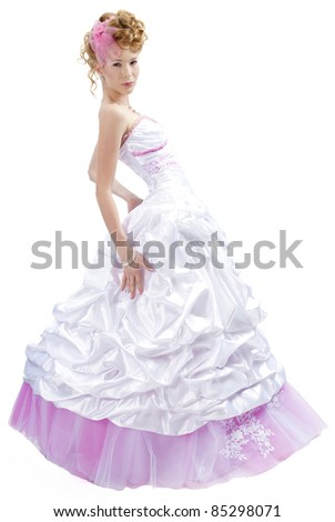 beautiful girl in wedding dress isolated on white