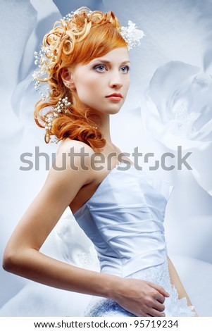 Beautiful girl in wedding dress with creative hair. Flowers background. - stock photo