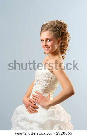 Beautiful Girl in wedding dress with Toothy Smile