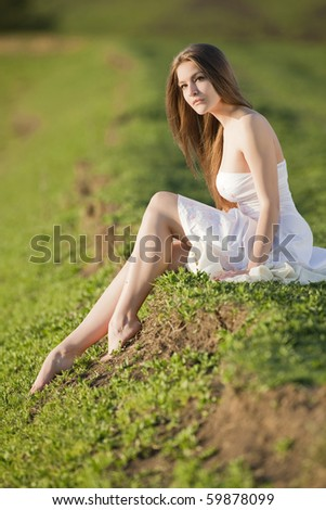 beautiful girl in white dress at outdoor shooting - stock photo