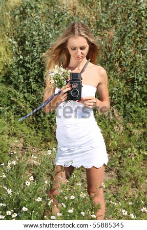 Beautiful girl in white dress with old TLR camera