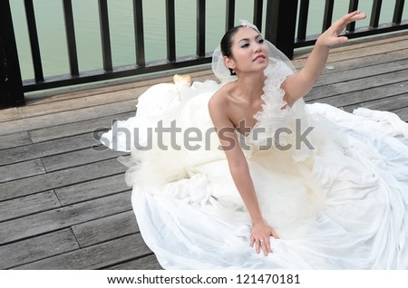 Beautiful girl in white gown of the bride dance