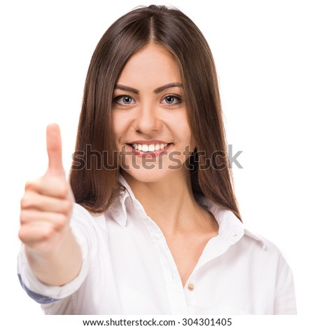 Beautiful girl in white shirt showing thumb up on white background.