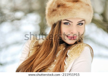 Beautiful girl in winter - close up - stock photo