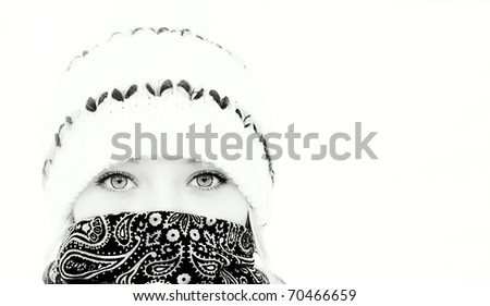 Beautiful girl in winter hat, black and white - stock photo