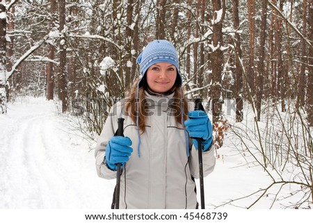 beautiful girl in winter with cross-country skiing - stock photo