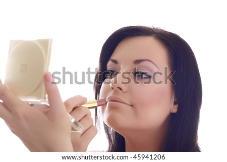 Beautiful girl in with make-up cosmetics