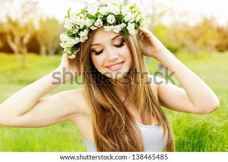 beautiful girl in wreath of flowers - stock photo