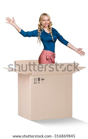 Beautiful girl inside a cardboard box makes surprise on the white background