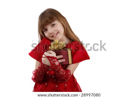 Beautiful girl is giving the gift. Female with present. Attractive lady is holding purple box with gold ribbon. Isolated over white background. - stock photo