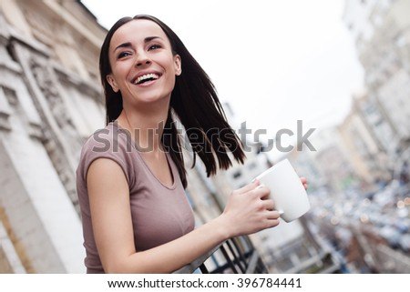 Beautiful girl is having a rest outdoors - stock photo