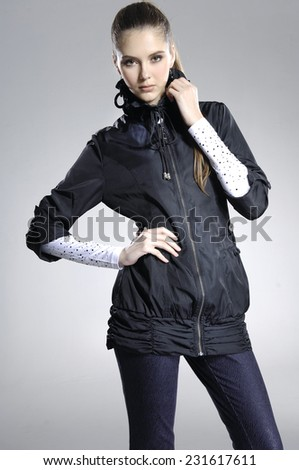 beautiful girl is in fashion style on light background