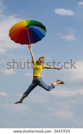 Beautiful girl is jumping from cloud to cloud - stock photo