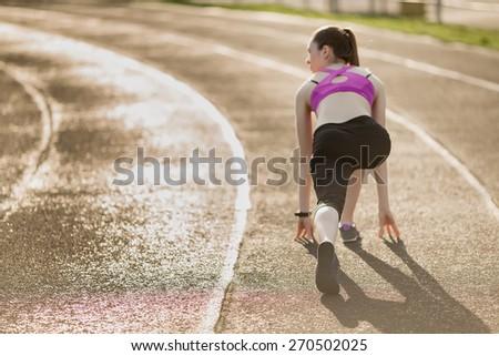 Beautiful girl is ready to run - stock photo
