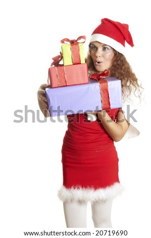 beautiful girl is surprised to a christmas gift