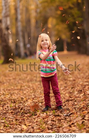Beautiful girl jumping in autumn park. active, to rest, to run