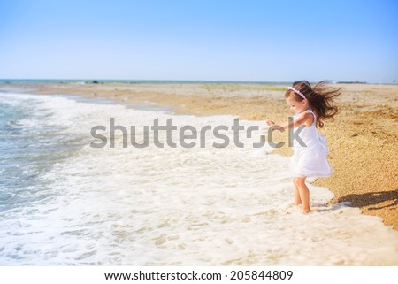 beautiful girl jumping on the beach, wind, rest, happiness - stock photo