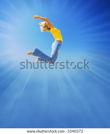 Beautiful girl jumps in the sky - stock photo
