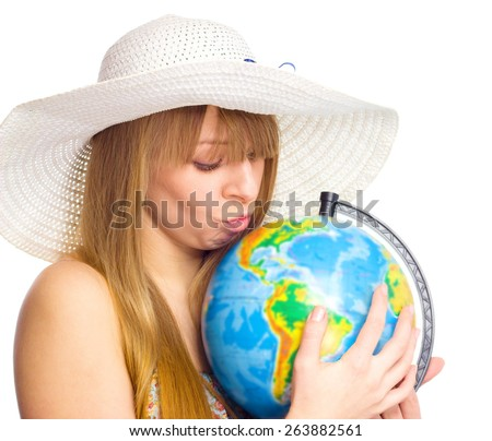 Beautiful  girl kissed a globe, isolated over white - stock photo