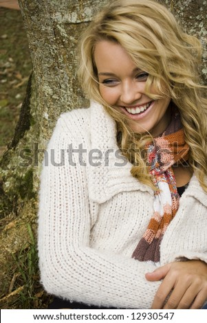 beautiful girl laughing in the park - stock photo