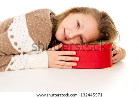 beautiful girl lies on a gift box - stock photo