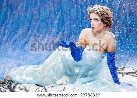 Beautiful girl like Snow White on blue background