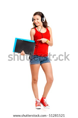 Beautiful girl listen music and holding some cases, isolated on white - stock photo