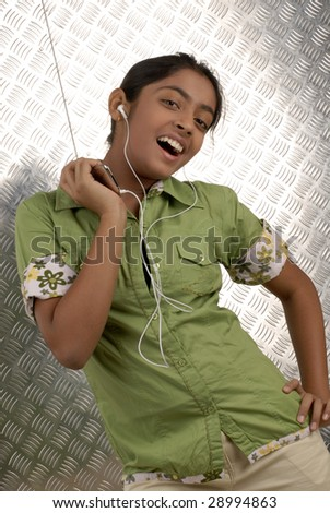 beautiful girl listening music on her portable CD player