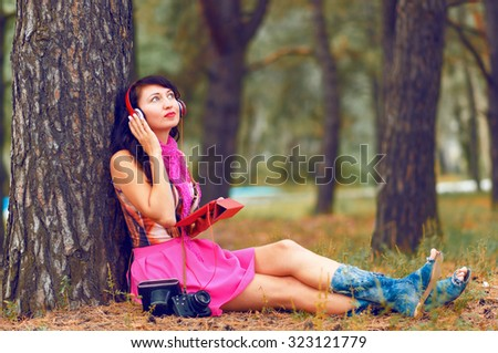 Beautiful girl listening to music on headphones. Young woman listening to music