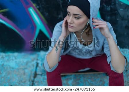 Beautiful girl listening to street music. - stock photo