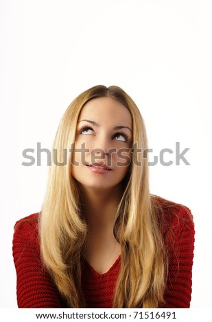 Beautiful girl looking in the corner, lots of copy space - stock photo