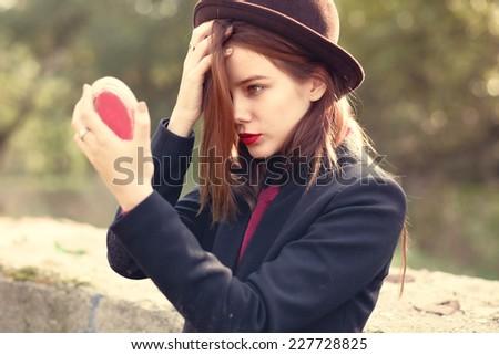 beautiful girl looking in the mirror - stock photo