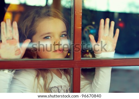 beautiful girl looking out the window. outside view - stock photo