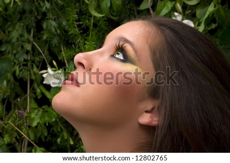 Beautiful girl looking up - stock photo