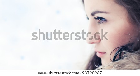 beautiful girl looks into the distance - stock photo