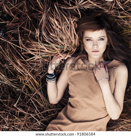 beautiful girl lying in grass - stock photo