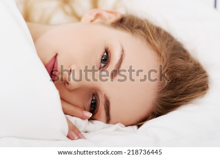 Beautiful girl lying on the bed. - stock photo
