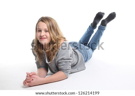 Beautiful girl lying on the ground - stock photo