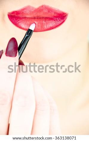 Beautiful girl makeup lips close up - stock photo