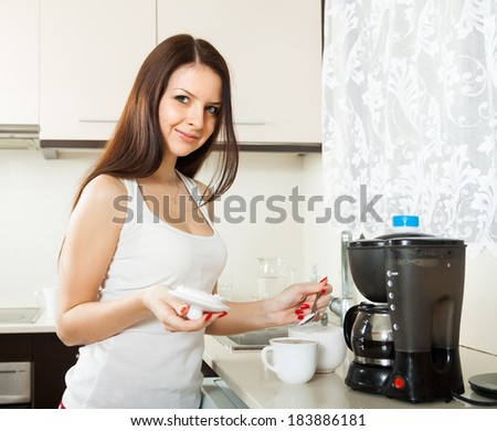 Beautiful girl making coffee for breakfast.  - stock photo
