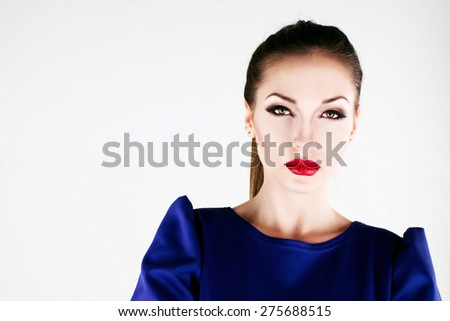Beautiful girl model in a blue dress.close up - stock photo