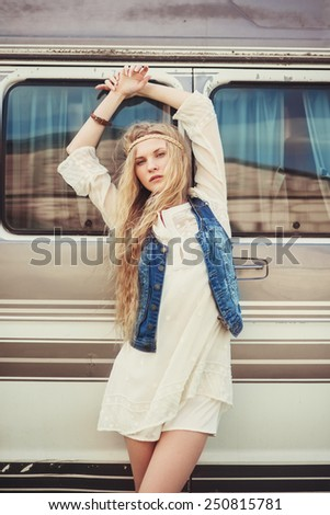 beautiful girl model posing on a background of the bus - stock photo